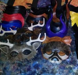 Leather masks, base dyed, in process.